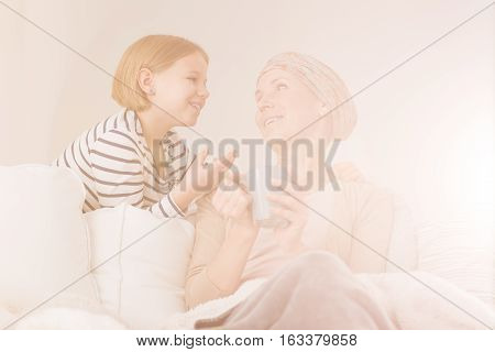Daughter Supporting Her Sick Mother
