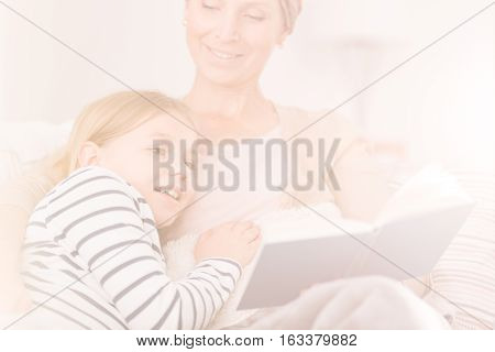 Ill Woman Reading To Daughter