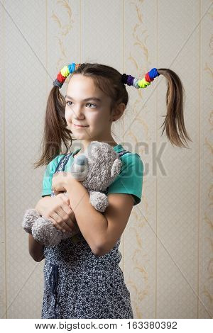 11 year old girl hugging a teddy bear