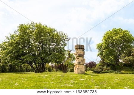 View on danube park with green grass, trees and stone statue, vienna, austria