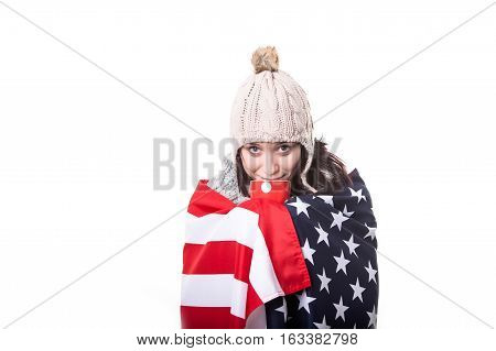 Naked young woman in American flag stand on a white backgrund.
