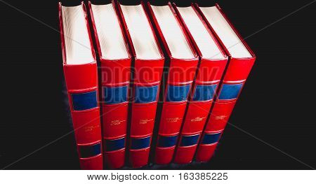 Old Encyclopedias On Black Background