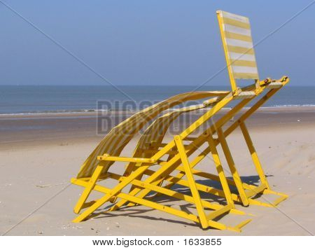 Seat Of A Beachchair Waving In The Wind