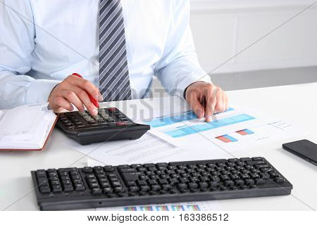 Male hands typing on laptop computer keyboard businessman seated in cafe working with computer businesspeople using modern devises crop of rich businessman in suit working with laptop computer