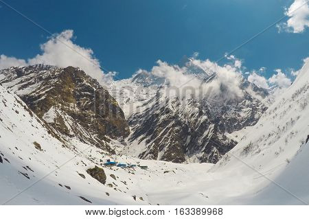 Mountain landscape. Trek to mountain Sagarmatha. National Park in Himalaya. White snow peaks and rocks landscape severe winter in cold climate. Nepal eco travel and sport