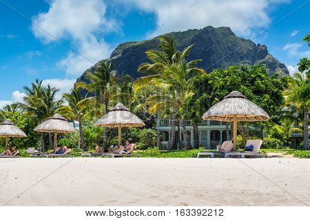 Le Morne Mauritius - December 7 2015: A sunny day on the Le Morne Brabant tropical beach one of the finest beaches in Mauritius and the site of many tourism facilities.
