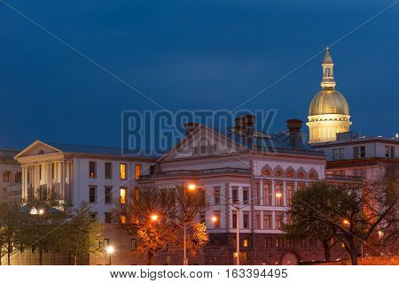 NJ state capitol complex at night in Trenton, New Jersey.