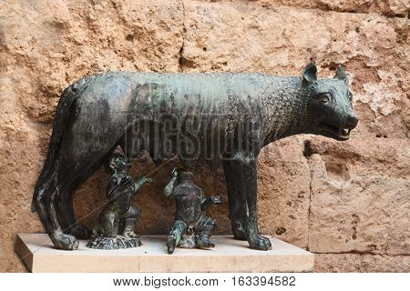 The Capitoline wolf is a bronze sculpture depicting a she-wolf fed with the milk of two infants -- Romulus and Remus the legendary founders of Rome