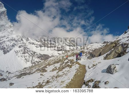 Mountain landscape. Trek to mountain Sagarmatha. National Park in Himalaya. White snow and rocky peaks. Nepalese severe winter. Nepal eco travel and extreme sport. Outdoor traveling