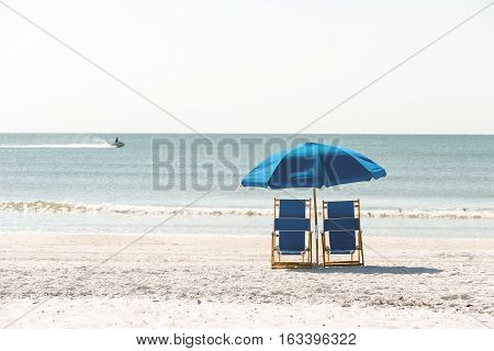 Lounge chairs on pristine sandy beach of Fort Meyers, Florida