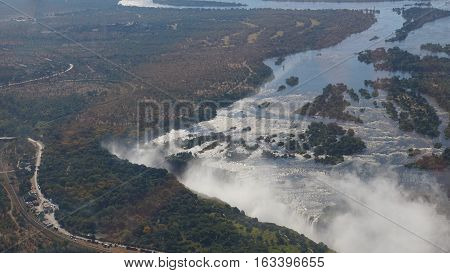 The Zambezi River in Zambia, the break-off edge and the spray of Victoria Falls, landscape in Zimbabwe