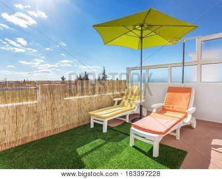 Cozy Corner on the terrace for sunbathing and relaxing. Summer for turists