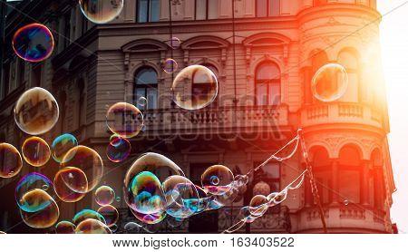 Prague Czech Republic .Soap bubbles in the center of Prague on the sun.