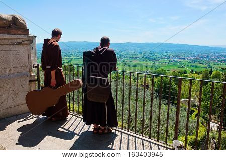 5 may 2014-assisi-italy- Friars with the guitar in the city of Assisi