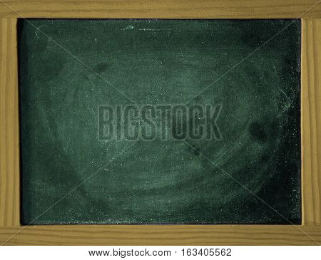 a green chalkboard with a wooden frame