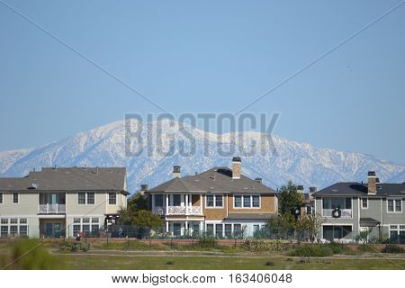 The snow capped San Gabriel Mountains seen from Bolsa Chica Ecological reserve in southern California, approximately 65 mile distance.
