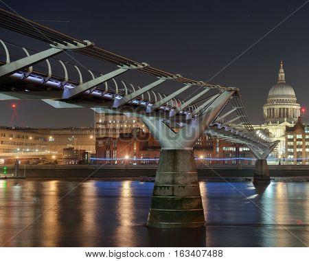 The Millennium bridge and London River Thames skyline
