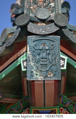 Intricate sculpted pieces on the  pavilion covering the Korean  Bell of friendship  in Angel's Gate Park. San Pedro, California