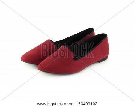 Two beautiful crimson female shoes without heels isolated on white closeup