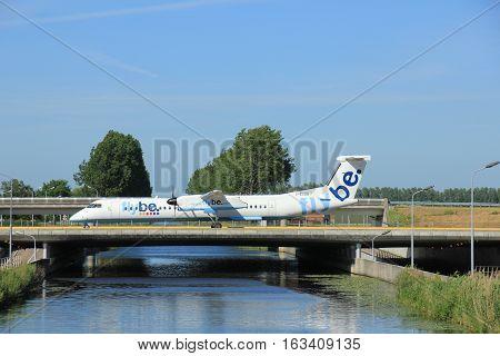 Amsterdam the Netherlands - June 9th 2016: G-ECOB Flybe De Havilland Canada DHC-8-402Q Dash 8 taxiing to Polderbaan runway Schiphol destination Birmingham United Kingdom