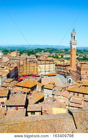 The Torre del Mangia, tower located in the ancient medieval historical city centre at Piazza del Campoin in Siena, Tuscany region, Italy