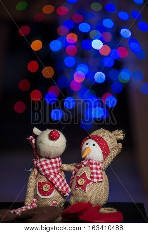 Christmas figurine toys on colorful bokeh background