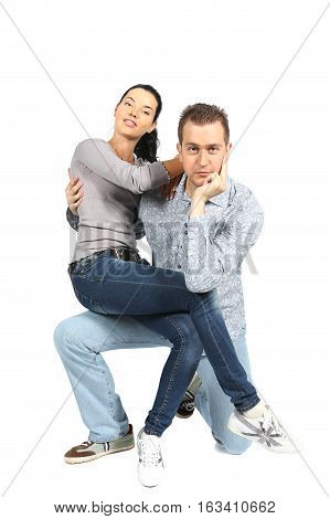 Portrait of happy young loving couple looking at camera on white background