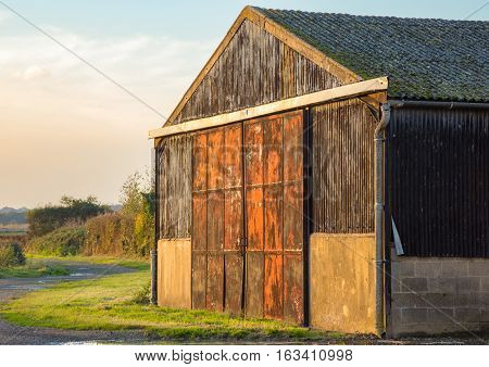 Barn is on farmland near the village of Abridge in Essex England on a bright autumn day.