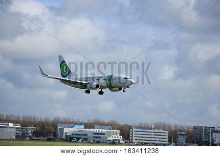 Amsterdam The Netherlands april 11 2015: PH-XRX Transavia Boeing 737-700 approaching runway 09-27 Buitenveldert