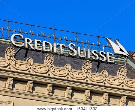 Zurich, Switzerland - 27 December, 2016: sign on the top of the Credit Suisse headquarter building on Paradeplatz square. Credit Suisse Group is a Swiss multinational financial services holding company, headquartered in Zurich.