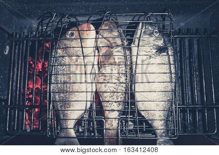 Fish On Barbecue Grill - Three Fishes On Fire