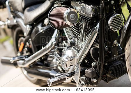 Shiny chrome detail of motorcycle engine block.