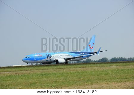 Amsterdam The Netherlands - June 12 2015: PH-TFB Arke Boeing 737-800 takes off at Amsterdam Airport Schiphol Polderbaan runway. TUI Airlines Netherlands trading as Arke is a Dutch charter airline headquartered in Schiphol-Rijk