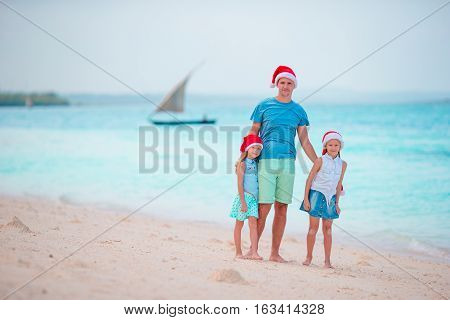 Father with kids on Christmas vacation. Christmas family holidays on the bea