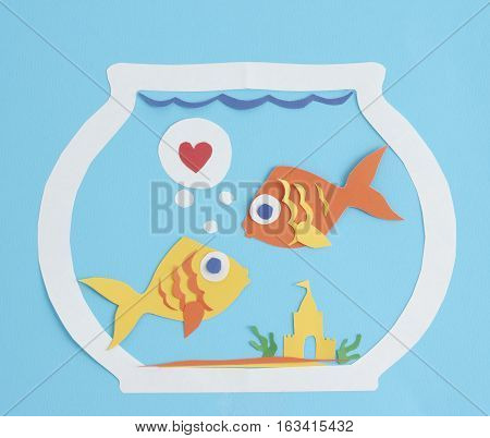 Paper fish friends or couple in a fishbowl