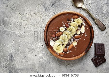 Chocolate Banana Smoothie Bowl With Nuts And Chia Seeds.top View.