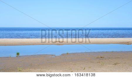 Ladoga lake at sunny day the Karelian Isthmus Russia.