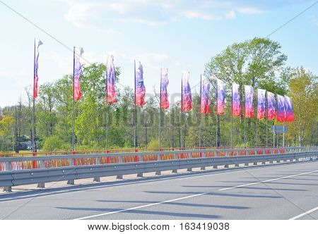 Bridge decorated with flags in Priozersk the Karelian Isthmus Russia.