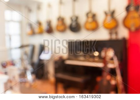 Blur abstract background with instrumentsin music store, stock photo
