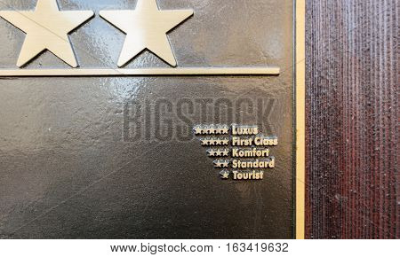 Detail of Hotel star rankings on three star German hotel facade - five star for luxury four stars for first class three stars for comfort two stars for standart and one star for tourist