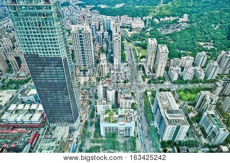 Business concept for real estate and corporate construction : panoramic modern city bird eye view with morning cloudy grey sky from 101 building in Taipei Taiwan