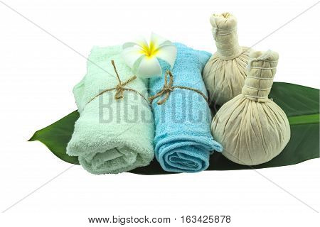 Spa herbal compressing ball white frangipani flowers (Plumeria spp flower Apocynaceae flower Pagoda tree flower Temple tree flower) and blue faric in green leaf isolate on white background.Saved with clipping path