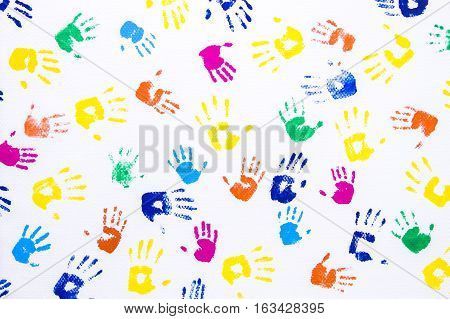 Kid's color hand printed on white background. Many children's and adult hands