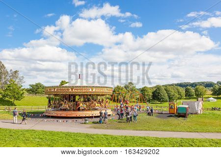 BEAMISH UK - JULY 27 2012: Built in 1893, the Steam Gallopers are a fine example of the carousels of the heyday of fairs. Powered by a steam and given music by a Gavioli organ the Gallopers are situated at Beamish Museum in North East England.