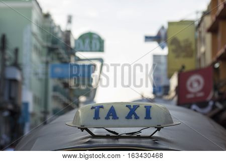 BANGKOK THAILAND - DEC 24 : taxi cab on top of tuktuk car in Khao San road on december 24 2016. tuktuk is popular server for tourist in Bangkok.