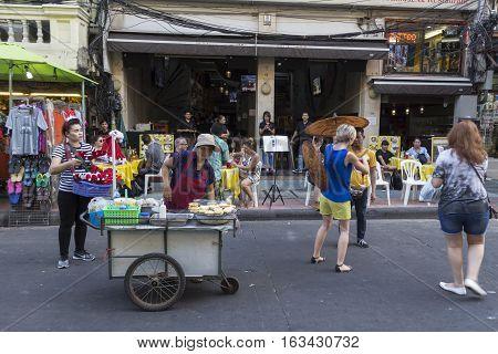 BANGKOK THAILAND - DEC 24 : street food cart stall in Khao San road on december 24 2016. Khao San road is big tourist hub of Bangkok.
