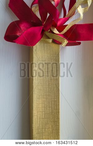 golden oblong present box with red and golden bow