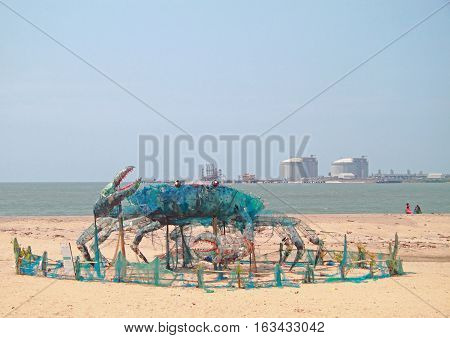 Kochi, India - March 7, 2015: art installation Mad Crab built of wastes on a beach in Kochi India