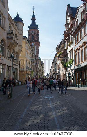 HEIDELBERG, GERMANY - MAR 29, 2014: Tourists walking at the main street Haptstrasse