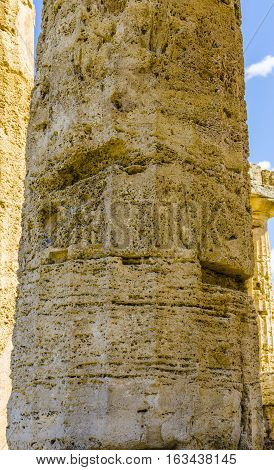 Closeup details of greek temple columns within the site. Italy